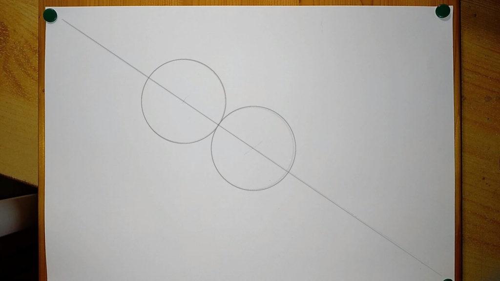 zwei Kreise auf einer Diagonalen