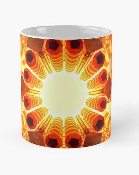"""Bild von einer Tasse mit dem Motiv vom Mandala """"die Reise ins Licht"""" als Aufdruck"""