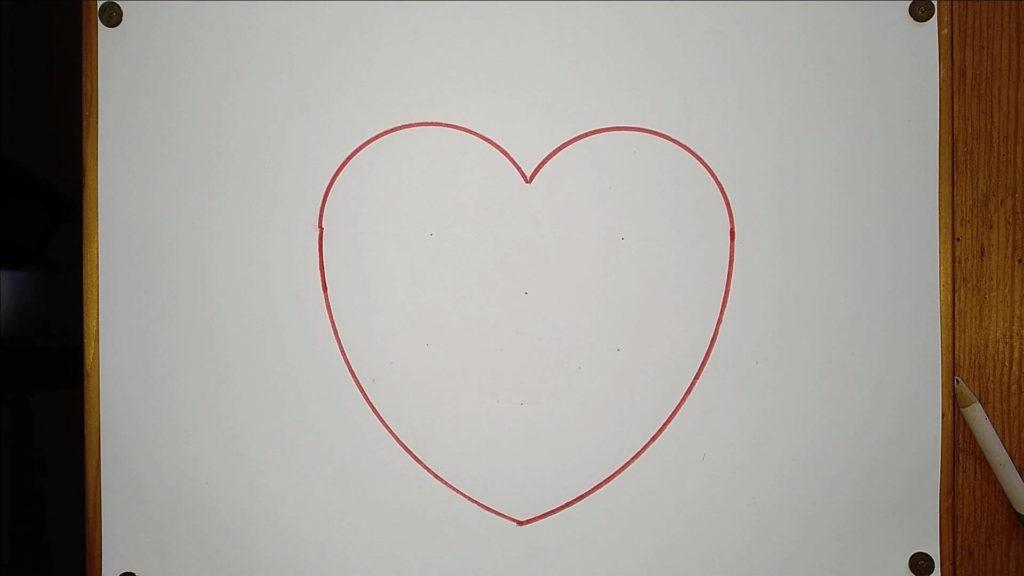 Bild von einem gezeichneten roten Herzchen. Anleitung: ein Herz zeichne
