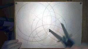 Bild mit vier gezeichneten Ringen auf der DIN A4 Seite - das Grundkonsturkt zur Anleitung einen keltischen Knoten zeichnen , Tutorial keltischer Dreieicksknoten